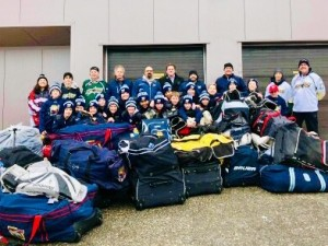 Sports Med team-MPW AE hockey equip donation